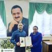 Патимат Мустафаева вручает Свидетельство стипендиата Фонда имени Г. Махачева Зайнодину Расулову.jpg